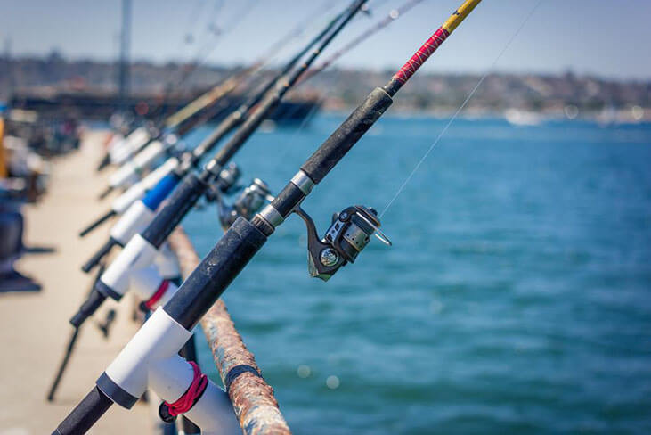 Fishing Polls in a Row on Pier in San Diego Bay, California.