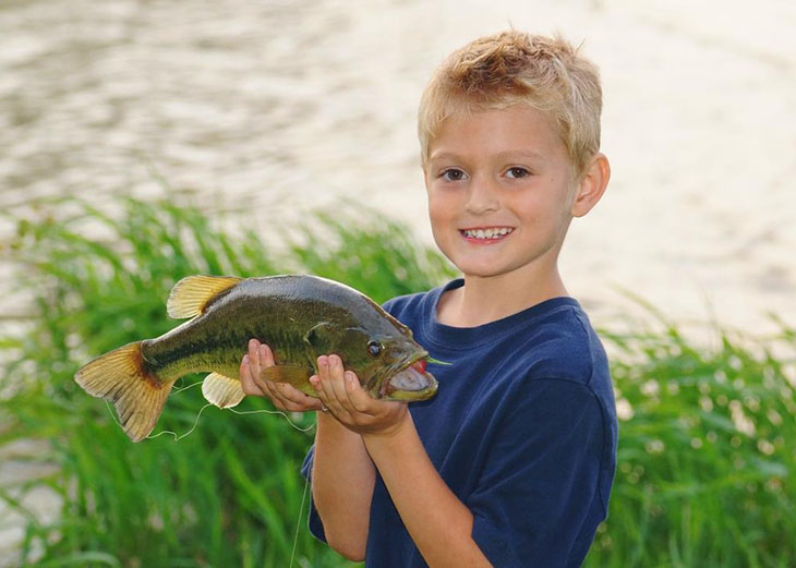 Largemouth Bass on kid's hand